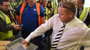 Mike Ashley flashes wad of £50 notes at Sports Direct HQ