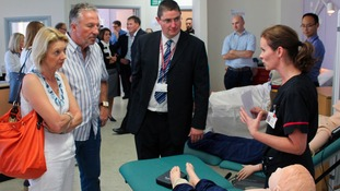 Sir Ian and Lady Botham enjoy a demonstration of one of the high-tech training simulation manikins at the simulation suite