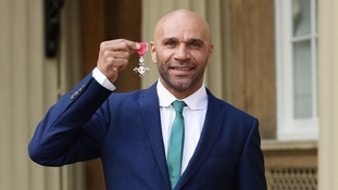 Goldie pictured at Buckingham Palace after receiving his MBE.