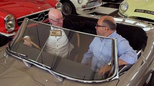 2 men in classic car
