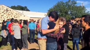 Students at Alpine High School comfort each other after the attack