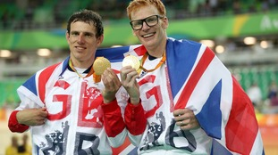 Steve Bate (right) and Adam Duggleby pose with their gold medals.
