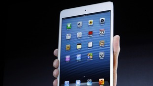 The new iPad mini is projected on a screen