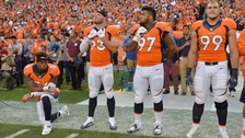 Brandon Marshall kneels during the national anthem.