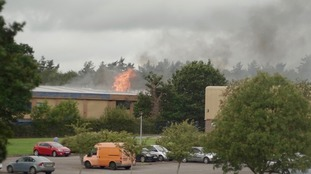 Firefighters tackle a blaze at a large commercial building