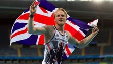 Jonnie Peacock celebrates after winning his second gold