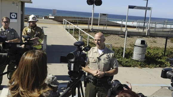Police updating the media about the shark attack