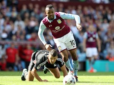 Aston Villa's Jordan Ayew (right) and Nottingham Forest's Eric Lichaj battle for the ball at Villa Park in Birmingham.