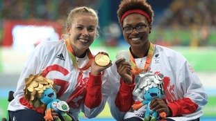 Hannah Cockroft (left) on the podium with her gold medal alongside compatriot Kare Adenegan with her silver medal following the Women's 100m T34 Final.