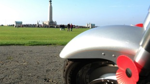 The HM Forces Scooter club park up at the Portsmouth Cenotaph during a service on Remembrance Sunday