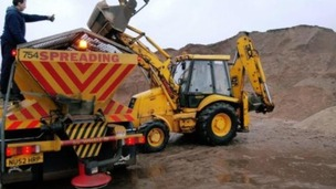Grit is loaded into a gritting lorry