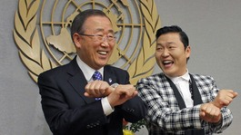 "South Korean singer Psy practises some ""Gangnam Style"" dance steps with UN Secretary-General Ban Ki-moon at the UN headquarters"