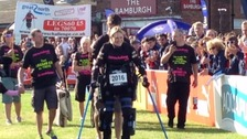 Claire Lomas reaches the finishing line of the Great North Run.