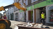 The front of a supermarket in Clare in Suffolk has been wrecked after thieves used a digger to steal a cash machine.