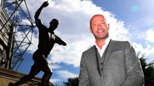 Alan Shearer with his statue at St James's Park