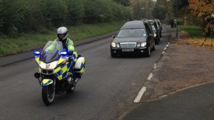 The funeral cortege was accompanied by police