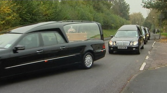 The funeral cortege arrives