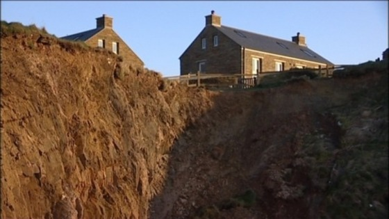 The house in Torquay was left teetering on a cliff edge.