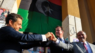 Nicolas Sarkozy (L), David Cameron (C) and then National Transitional Council (NTC) head Mustafa Abdul Jalil (R) join hands in Benghazi in 2011.
