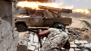 Libyan forces allied with the UN-backed government fire weapons during a battle with IS in July 2016.