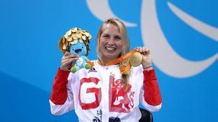 Stephanie Millward celebrates her gold win in the 100m backstroke.