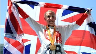 Georgina Hermitage celebrates after setting a new world record in the 400m T37.
