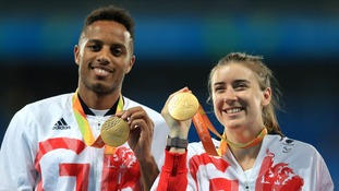 Clegg and guide Chris Clarke celebrate with their gold medals after winning the 200m T11 final.