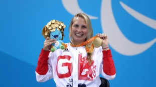 Stephanie Millward proudly displaying her gold medal
