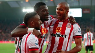 Sunderland's Lamine Kone (centre) celebrates scoring his side's third goal of the game with teammates Jermain Defoe (left) and Younes Kaboul