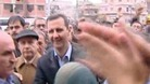 President Bashar Al-Assad is greeted by crowds in Homs.