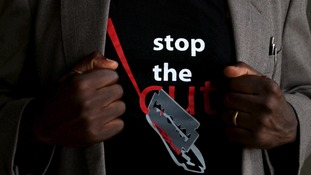A man wears a T-shirt promoting an anti-FGM campaign.
