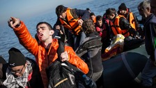 Refugees and migrants on an overcrowded rubber dinghy boat near Lesbos in Greece.