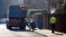 Council workers collect bins.