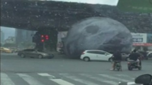 Giant inflatable moon causes chaos on streets of China