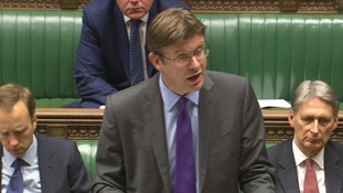 Changes to the Hinkley Point deal will secure the national interest, Greg Clark told parliament.