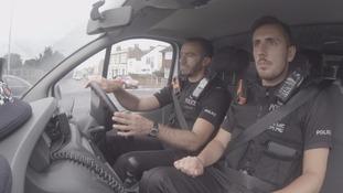 police on patrol in car