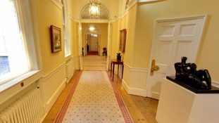 The hallway leading down to the front door.