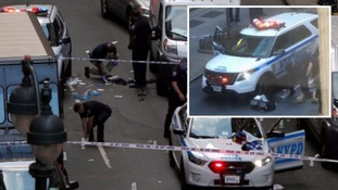 Manhattan meat cleaver attack: NYPD fire 18 shots amid commuters to halt attacker who slashed cop