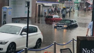 Heatwave comes to an abrupt end as torrential rain sweeps across the South East