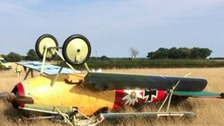 A vintage plane crash lands