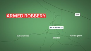 Police have launched a search for armed raiders after a robbery at Beccles in Suffolk