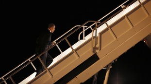 Barack Obama boarding Air Force One as he leaves California