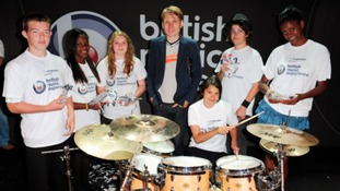 Alex Kapranos of Franz Ferdinand with schoolchildren at the British Music Experience in London