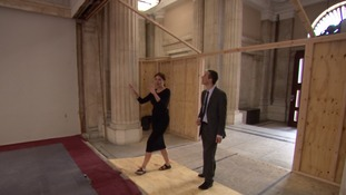 Development Director Liz Koravos shows Andy Bonner around the building