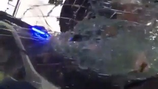 Shocking footage shows police officer smashing car windscreen