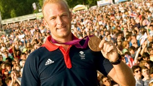Men's Eight rower Alex Partridge with his London 2012 bronze medal.