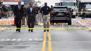 New York Mayor Bill de Blasio and New York Governor Andrew Cuomo survey the site of the blast.
