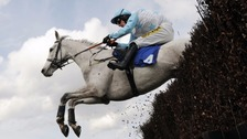 Mania puts retirement on hold for Aintree race