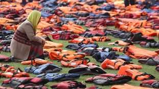 Activists have laid out a 'grave yard of life jackets' in Parliament Square