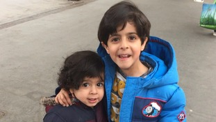 Joseph with his two-year-old brother Ali.